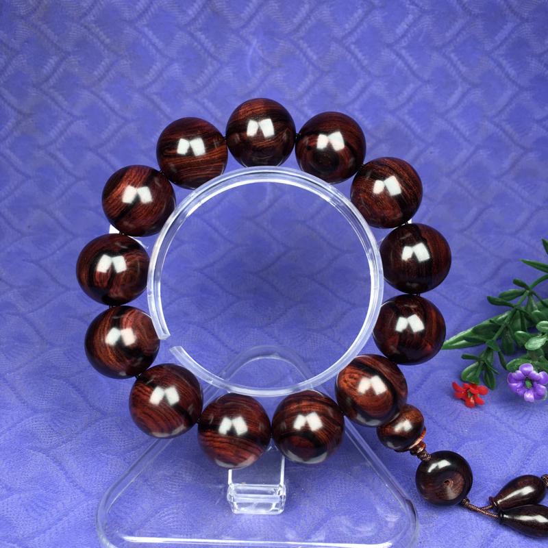 海南黄花梨紫色老油梨,一线天纹理,一刀料,纯手工精工制作工艺。规格是:18mmX13颗,密度:42.