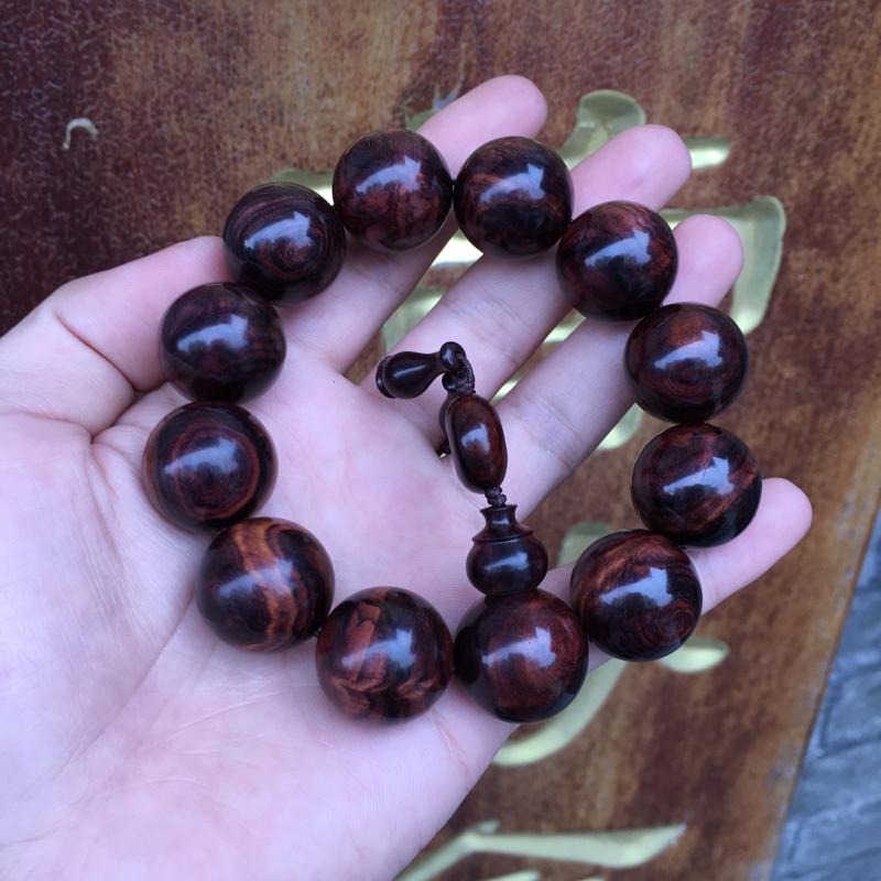 海南黄花梨精品紫油梨手串,水波纹理,山水纹理,上手易包浆,纹理清晰,高油高密,底色干净,色泽均匀,规