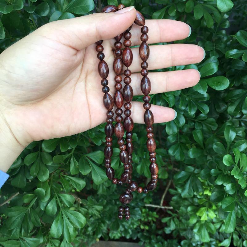 海南黄花梨油梨橄榄珠项链,规格:14mm×8mm,大珠26粒,小珠54粒,同料制作,高油高密,底色干