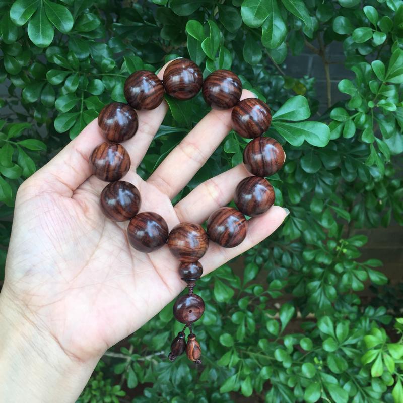 【海南黄花梨油梨2.0规格的手串,材质一流,质感非常好,顺纹纹路清晰可见,顺纹代表着,顺顺利利,一顺到底!克重53.3g】图12