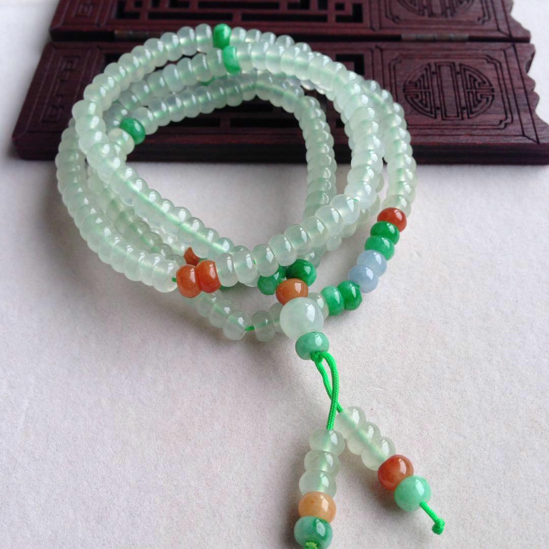 冰糯晴水绿底色三彩算盘珠子毛衣链,种水老通透,玉质细腻,饱满圆润,个别有石纹,尺寸5.8*3.3mm