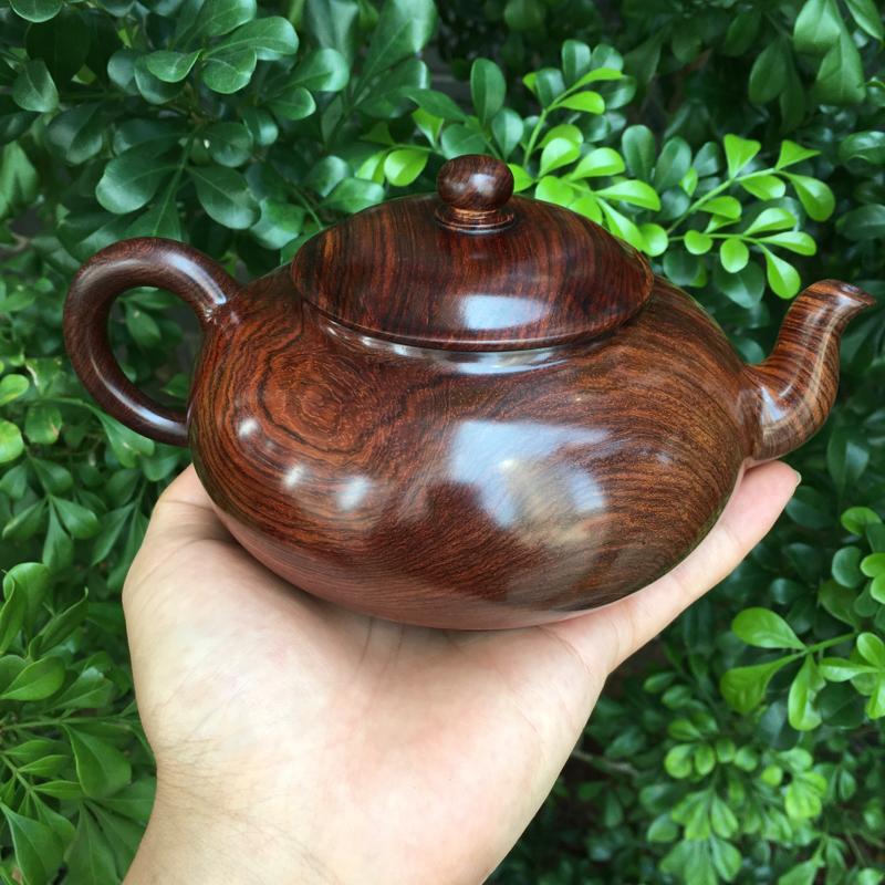 海南黄花梨油梨茶壶,规格:壶经:125mm,长:180mm,高:98mm,克重:508.3克,纹理清
