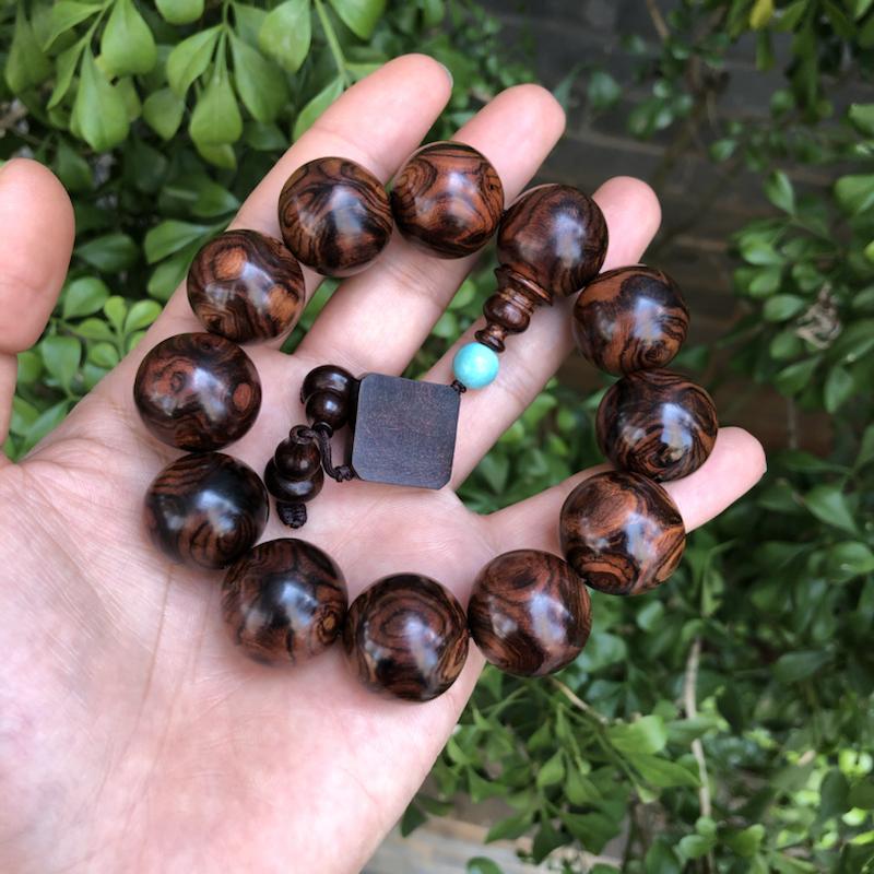 海南黄花梨油梨对眼手串,规格:20mm×12,克重:48克,对眼蜘蛛纹,纹理清晰,底色分布均匀,盘玩