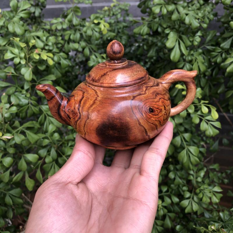 海南黄花梨,油梨茶壶,宽度91.6mm,长140mm,高:91mm,克重206克,纹理清晰,底色干净