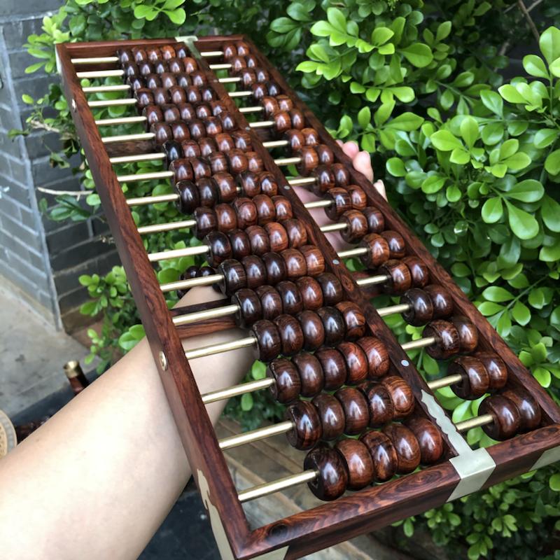 海南黄花梨,17档算盘,油梨制作,品相完美,纹理清晰,做工精细,底色分布均匀,规格:长475mm,宽