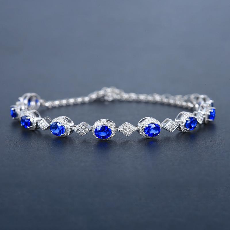 矢车菊蓝蓝宝石手链,材质:18k金,配石:钻石,宝石参数:3.23ct,配石:234颗,总重5.84