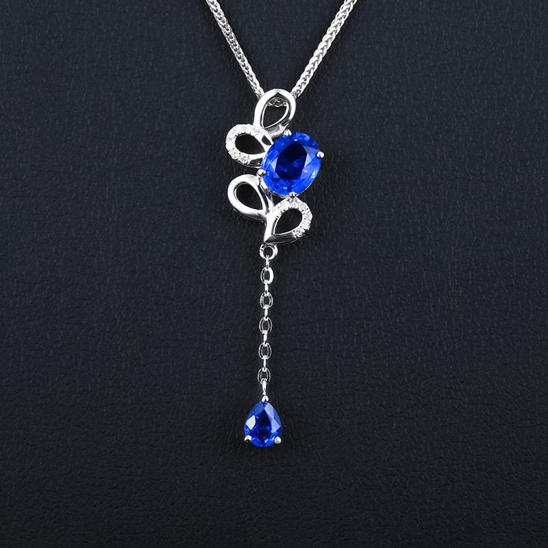 18k金镶蓝宝石吊坠 宝石参数:1.0ct  配石:钻石14颗,总重1.18克,配18k金链